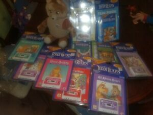 NEW~Huge Teddy Ruxpin world of wonder lot. Teddy, 6 Tapes w/book, 4 VHS w/ Book