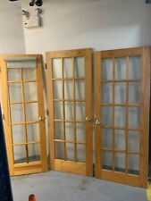 3 Medium Wood Tone French Doors with Glass Panels. Individual Sale Available.