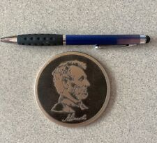 Token featuring Jfk on one side and A. Lincoln on the other/black and silver