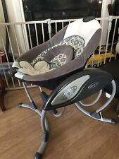 graco glider lx gliding swing, in grey. Swings, vibrates and plays music