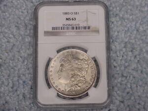 1883 O MORGAN $1 NGC MS 63 1 OZ  SILVER COIN IN SLAB