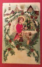 CPA. NOËL. 1907. Ange. Cadeaux. Enfants.Village.Gaufrée.Embossed. Corsage Tissu?