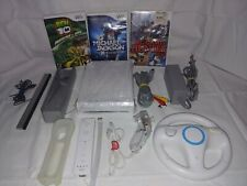 White Nintendo Wii with games