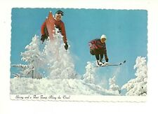 SKIING AND A FAST JUMP ALONG THE TRAIL. LABELLE, QUEBEC, CANADA POSTCARD