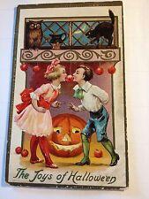 Halloween postcard J R Cornwell boy girl passing apple owl black cat JOL smiles