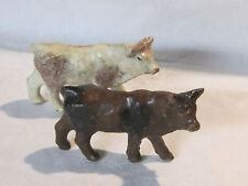 Pair of vintage painted composition cows for Christmas nativity or village scene