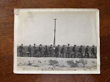Conga line band music instrument case railroad track telephone pole California