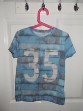 Boy's Blue T-shirt from Marks and Spencer. Size 7-8 years