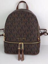 44a57cab32bd Michael Kors Rhea Medium MK Signature Backpack in Brown