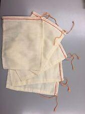 25 (5x7inch) Cotton Muslin Red Hem, Orange Drawstring Bag