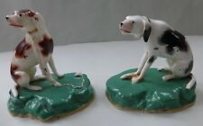 SUPERB PAIR 19THC. PORCELANOUS HOUNDS ON RAISED GREEN BASES. C.1845