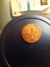 2000, no mint mark, penny, off center shallow striking error, pit in memorial.