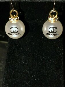 CHANEL AUTHENTIC PEARL WITH LOGO  AND RHINESTONE EARRINGS