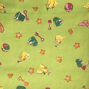 100% cotton beach themed fabric with sand toys on a lime green ground ~1-1/4 yd