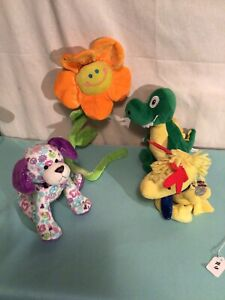 LOT OF 4 DOG PUPPIE PLUSH TOYS DRAGON  FLOWER SNOOPY PUPPY W / PEACE SIGN