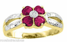 Ruby and Diamond Ring set in Flower Design set in 14k Yellow Gold