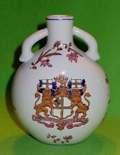 Vintage Chinese jug with raised relief British East India Company coat of arms.