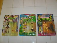 3 DIFFERENT TEENAGE NINJA TURTLES APRIL FIGURES, ON CARD
