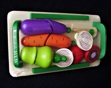 Cutting Vegetables on a board - wooden toy