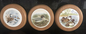 Three Wall Tiled Plaques with Wood Surrounds or Teapot Stands