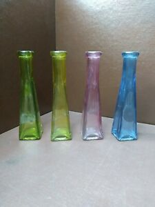 "Lot of 4 Colored Glass Bottles/ Bud Vases 6 ½"" Tall"