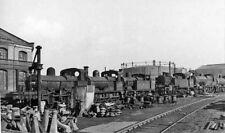 PHOTO  DERBYSHIRE  ROW OF LOCOMOTIVES AT DERBY WORKS SCRAPYARD 1950