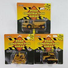 ERTL Road Construction Ahead Caterpillar Die-Cast Set of 3 Tractor & Truck New