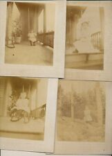 4 Cabinet Photo of Young Child on a swing, in garden, on front porch,  in rocker