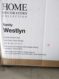 Westlyn 4-Light Brushed Brass Vanity Light with Clear Optic Glass Shades by HDC