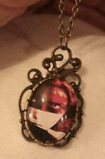 Lovely Swoop Swirled Brasstone Mysterious Swath-Masked Lady Pendant Necklace