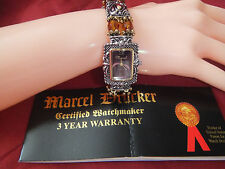 Marcel Drucker Collection Grandeur Watch features multi-faceted amber beads