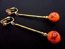 A PAIR OF LONG ORANGE PORCELAIN BEAD  GOLD PLATED CLIP ON EARRINGS. NEW.