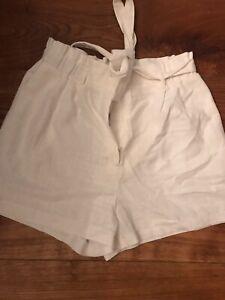 Lovely  Stylish H&M White Shorts.  BNWT size 14
