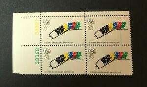 #1461 8 Cent Olympics Bobsled Blue ink smear Variety