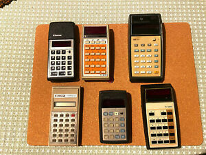 Six old hand held calculators from the 70's and 80's