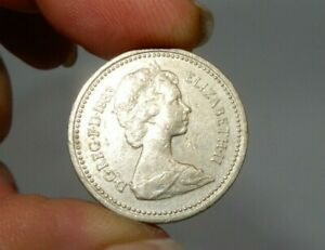 Rare 1983 UK Royal Arms Pound Coin with Writing Error