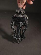 interesting cast iron victorian door knocker