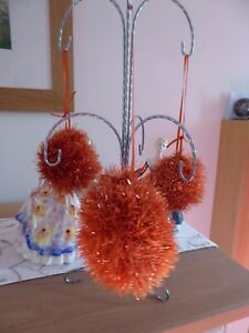 Hand knitted Christmas tinsel bauble Orange