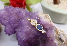 """9CT (375) Y/G PENDANT- Blue Cubic Zironia """"BUNNY"""" (25mmx7.5mm) 0.9gr"""