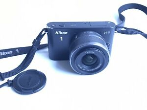 NIKON 1 J1 avec NIKKOR VR 10-30mm f: 3.5/5.6 + chargeur batterie carte SDHC 16GB