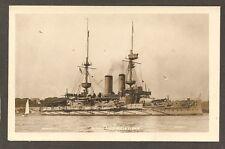 REAL-PHOTO POSTCARD:  H.M.S. IRRESISTABLE - PRE-WW-1 BRITISH NAVY BATTLESHIP