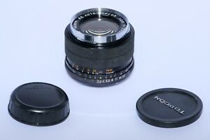Topcon RE Auto Topcor 28mm f2.8 wide angle lens in Black with caps. Super D.