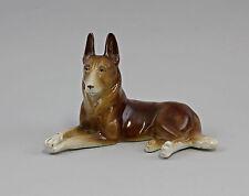 Figurine en Porcelaine allongé Chien de berger 99840371