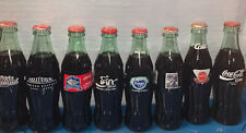 Collection Of 8 Commemorative Coca Cola Bottles