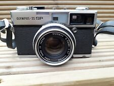 Olympus 35 SP camera with fitted G. Zuiko lens with original leather case