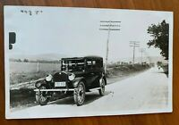 POSTCARD Vintage Early 1920s REO car on road RPPC? V-2