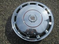 one 1989 to 1992 Cadillac Deville 15 inch hubcap wheel cover