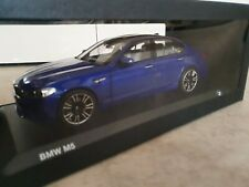 Norev  BMW M5 F90 in marina bay blue in 1.18 DEALER Collection.