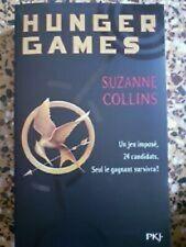 livre Hunger Games Tome 1 - suzanne collins en tres bon etat