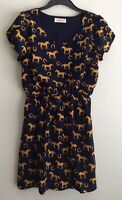 Blue color casual dress with horse print and yellow horseshoes. Marca Peach Love